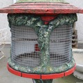 A painted concrete bird feeder